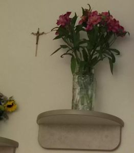 My flowers from my husband next to the cross that reminds me I'm so loved